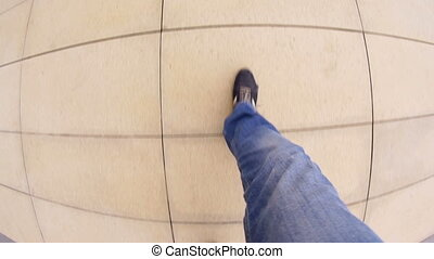 Men's feet going on the footpath - Men's feet going on a...