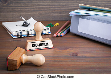 Iso-Norm. Rubber Stamp on desk in the Office