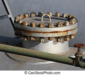 closed cap with steel bolt in an industrial refinery