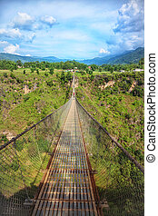 Long suspension bridge over a deep gorge