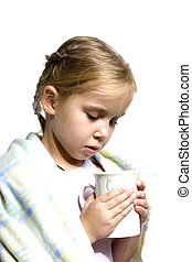 Child is ill with cup of tea in blanket