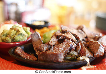 Steak fajitas at a restaurant.