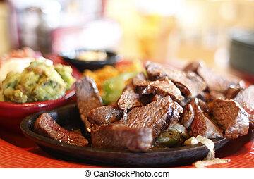 Steak fajitas at a restaurant.