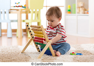 Baby boy playing with abacus - Baby kid boy playing with...
