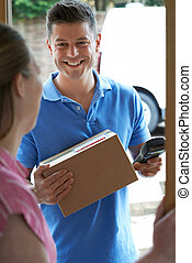 Courier Delivering Package To Domestic House