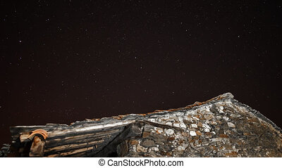 Old stone house and star trail time lapse - Time lapse of...