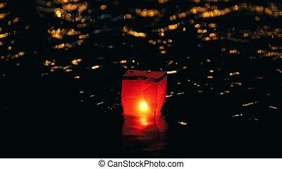 Floating lighting water Lanterns on river at night