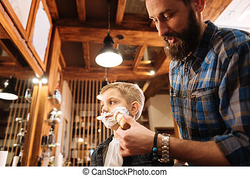 Nice bearded man shaving his client - Being handsome. Nice...