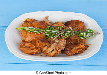 Source of chicken in sauce with a sprig of rosemary