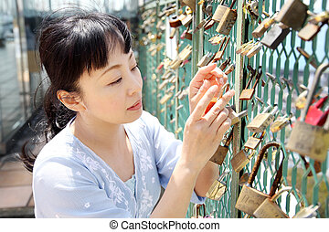 Young beautiful woman with padlock