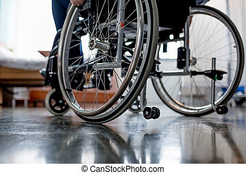 Senior patient in wheelchair - Partial view of senior male...
