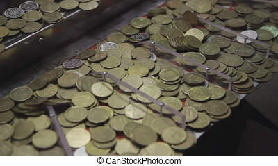 Playing an arcade coin game. - Dropping a coin into a...