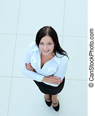 Smiling businesswoman view from above - Young smiling...