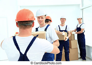 stevedores unload boxes in new premises - workers unload...