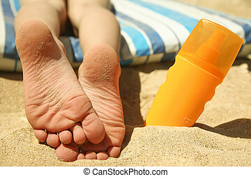 Legs of a child on the sand on the beach - a nice Legs of a...