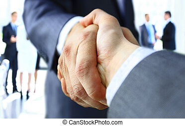 ha - Closeup of a business handshake