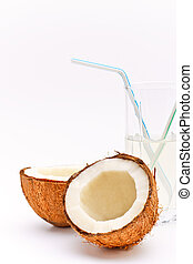 coconut and glass with coco milk - halves of coconut and...