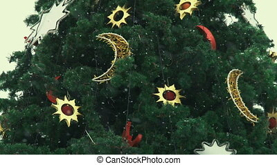 New Year decorative Christmas tree with decorations and snow falling