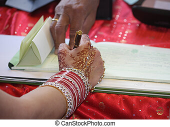 Signing the marriage register, Indian bride, England