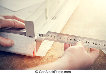 Man does measuring with slide calliper in paper cutter....