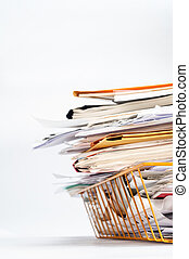 Office Tray Piled High with Messy Documents at Angle