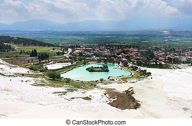 View of Pamukkale and city Denizli from top of the mountain