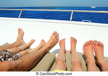 Legs of family on the sea - Legs of family at the yacht on...