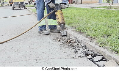 Construction worker is using jackhammer