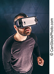 Man wearing virtual reality device