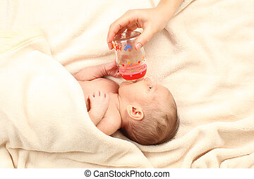 Mother bottle-feed her little baby