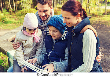 happy family with tablet pc at camp - camping, travel,...