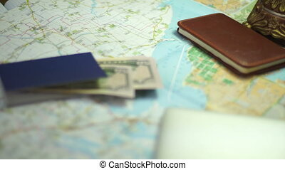 girl notes vacation destination on the map - close up of...