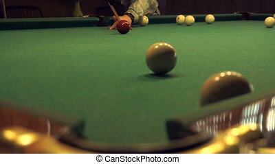 man plays Russian Billiards in slow motion