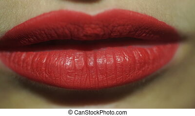 young girl with red lips eats potate chips - close up of...