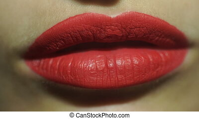 girl with beautiful large red lips eat potato chips - close...