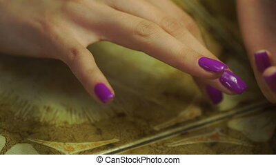 girl puts ring on her finger - girl with beautiful purple...