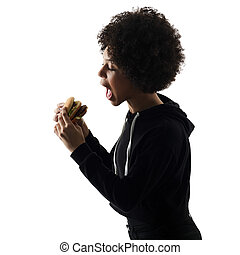 young teenager girl woman eating hamburger shadow silhouette...