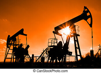 two oil pumps silhouette - two working oil pumps silhouette...