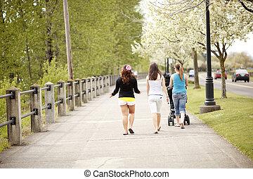 People walking on a boardwalk.