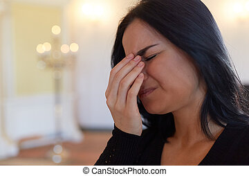 unhappy crying woman at funeral in church - burial, people...