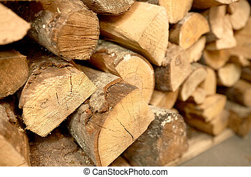 close up of firewood - stove heating and wood fuel concept -...