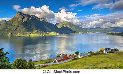 Norwegian fjord landscape on sunny day in august with houses...