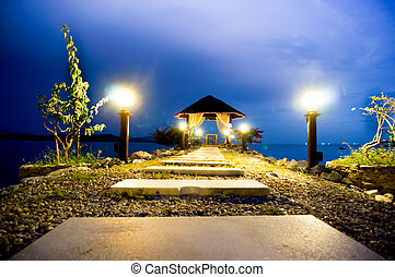 Stone path with lights leading to a hut - Stone path with...
