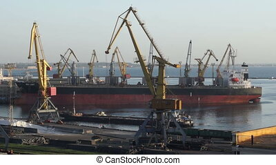 Crane seaport boat - Cargo ship moving load at port. Time...