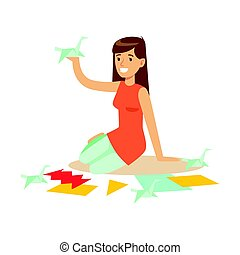 Cheerful young woman making origami cranes from colorful papper. Craft hobby and profession colorful character vector Illustration