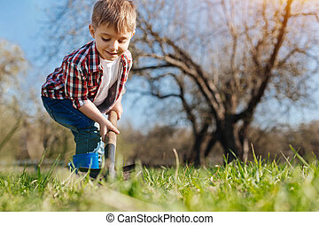 Industrious child gardening in spring - Young gardener. A...