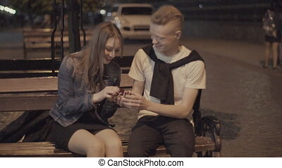 Guy presents a gift girl