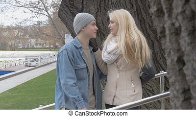 A beautiful sexy blonde and her boy frend talking on a date. Lively cheerful conversation, laughter and joy. On a beautiful sunny day.