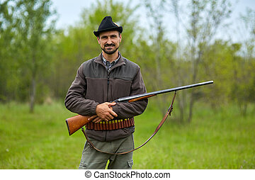 Hunter with shotgun in the forest - Hunter with a double...