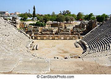 The amphitheater is near rock-cut tombs in Myra, Antalya,...